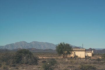 African house with corrugated iron roof in Swartberg semi desert