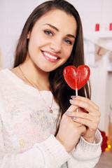 beautiful brunette with a lollipop