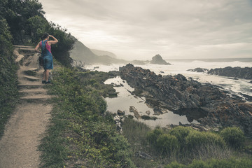 Female tourist viewing the wild coast of Tsitsikamma National Pa