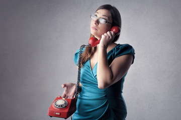 Woman waiting to talk on the phone