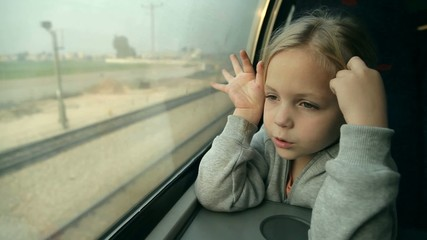 girl looking out the window on the train