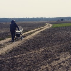 Father trolley walk field lonely