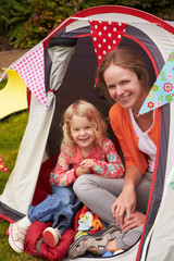 Mother And Daughter Enjoying Camping Holiday On Campsite
