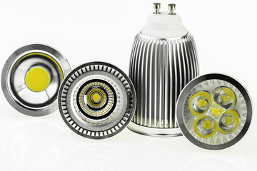 four GU10 LED bulbs with different sizes of chips and cooling