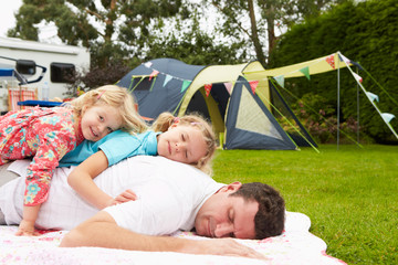 Father With Children Relaxing On Camping Holiday