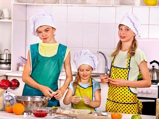 Children bake cookies.
