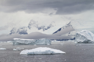 Dramatic Landscape - Coastline Of Antarctica And Icebergs