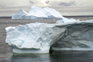 Antarctica - Non-Tabular Iceberg Drifting In The Ocean