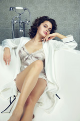 Sexy woman in bathroom in silk robe lingerie Valentine's day