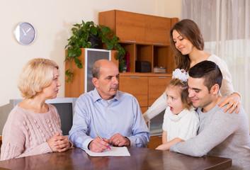 multigenerational family making shopping list