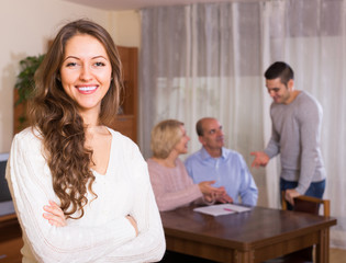 Girl staying near family members