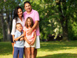 happy family of four posing outside - 76948480