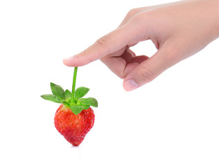 female hand and fresh strawberry isolated on white