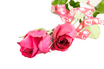 Red roses and red ribbons isolated on white background.