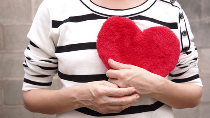Woman Holding a Red Fuzzy Heart