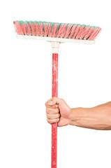 closeup of hand holding a broom
