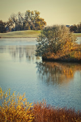 Beautiful lake on a cold autumn golf course