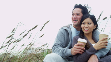 Laughing Ethnic Male Female Keeping Warm Outdoors Beach