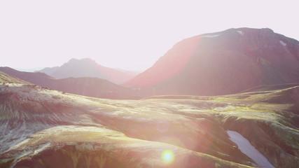 Aerial sun flare volcanic region mountain snow National Park Iceland