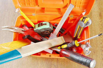 Plastic toolbox with various working tools. View from above