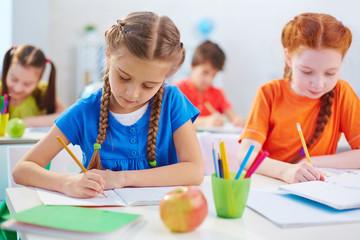 Schoolgirls drawing