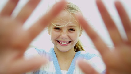 Happy Young Blonde Caucasian Girl Outdoors Fall Waving Camera
