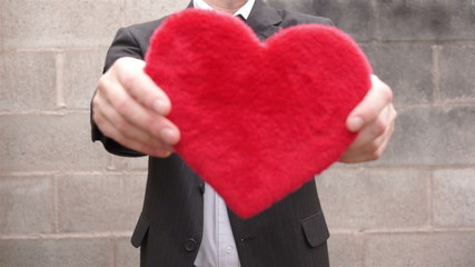 Man Turning and Holding Out Heart