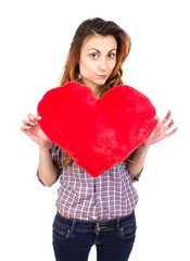woman holding a toy heart