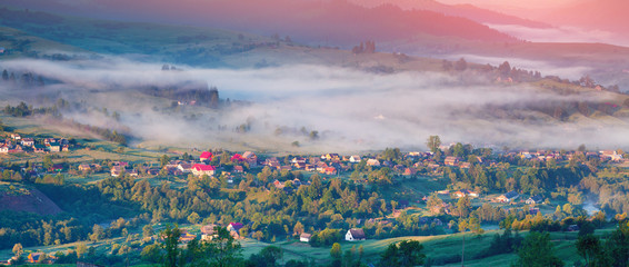 Colorful summer panorama of the sunrise un mountain village