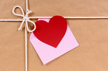 Brown paper package with valentine card