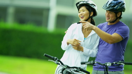 Young Heterosexual Ethnic Couple Cycling Fitness