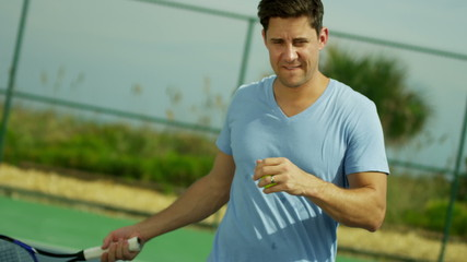 Active Young Caucasian Male Enjoying Tennis