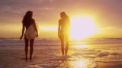 Young Caucasian Female Surfers Beach Ocean Shallows
