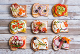Sandwiches on wooden background, top view