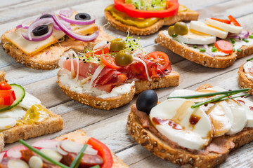 Sandwiches on wooden background, closeup