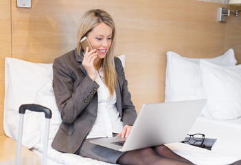 Business woman working with laptop computer in hotel room