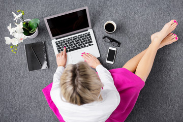 Creative young woman working with computer, view from above