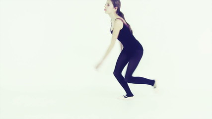 Cute teenager dancing in studio
