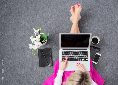 Woman working with computer, view from above - 76964016