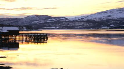 Norway winter sunset golden water Fjord nr Tromso panning