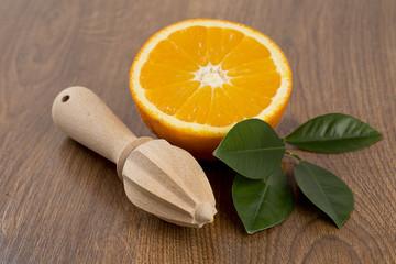 cut oranges on wooden surfce