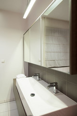 Double porcelain sink in bathroom