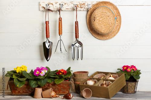Fotobehang Madeliefjes Garden tools hanging