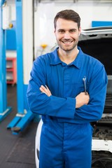 Mechanic smiling at the camera