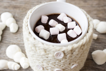 Covered cup of hot chocolate