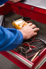 Mechanic taking a diagnostic tool from drawers