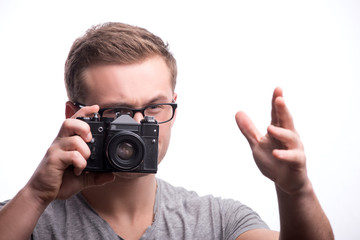 Young handsome man with photo camera