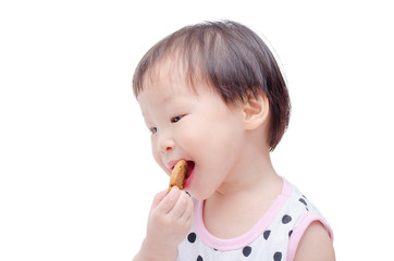 Little Asian girl eating cookie on white background