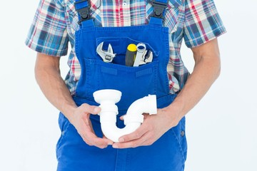 Cropped image of plumber holding sink pipe