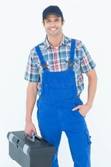 Confident plumber carrying tool box
